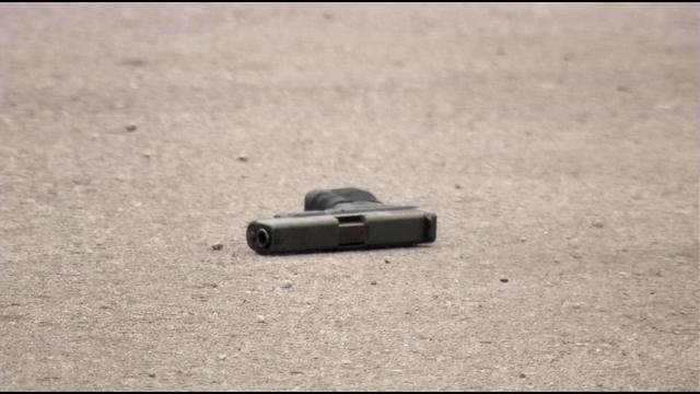 A gun was among the evidence police gathered at the scene of a deadly double shooting in a Valley Station parking lot on July 8, 2015.
