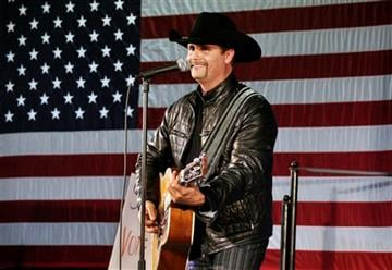 (AP Photo/Heather Ainsworth, File). In this Nov. 2, 2009 file photo, John Rich of the musical group, Big & Rich, performs at a rally for 23rd Congressional District candidate, Doug Hoffman, in Watertown, N.Y.