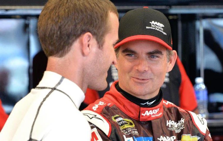 Jeff Gordon talks to fellow driver Kasey Kahne during a rain delay at Kentucky Speedway (AP photo.)