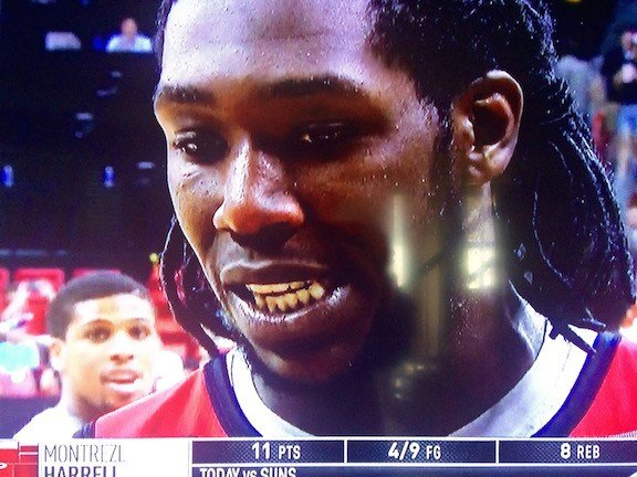 Wayne Blackshear photobombs his old Louisville teammate during a Montrezl Harrell postgame interview. NBA TV photo.