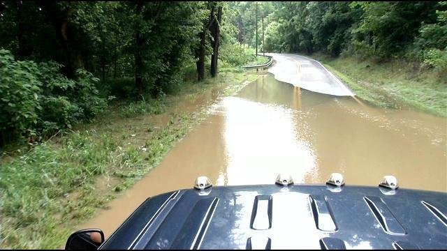 On nearby Grigsby Lane we hit another pool of water. The only people we saw willing to drive through were in pick up trucks.