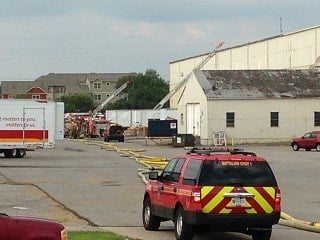Firefighters at recycling warehouse on Industry Road Wednesday night. WDRB News photo.