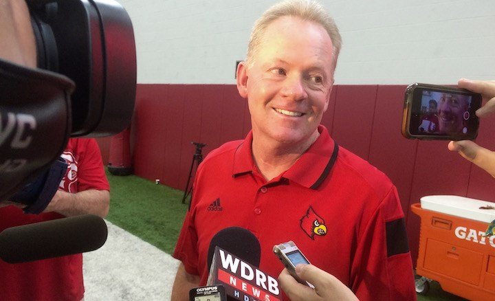 Louisville coach Bobby Petrino talks with reporters at a clinic sponsored by his Petrino Family Foundation on Saturday morning. (WDRB photo by Eric Crawford).