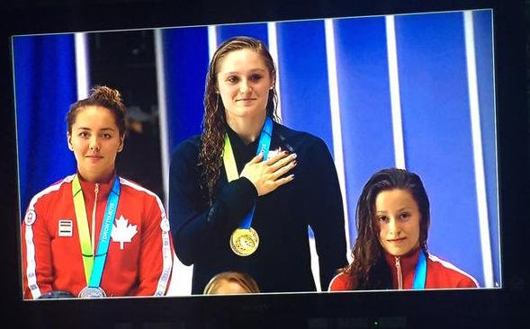 U of L swimming and diving Twitter photo -- Kelsi Worrell after winning the 100 meter butterfly at the Pan American Games.