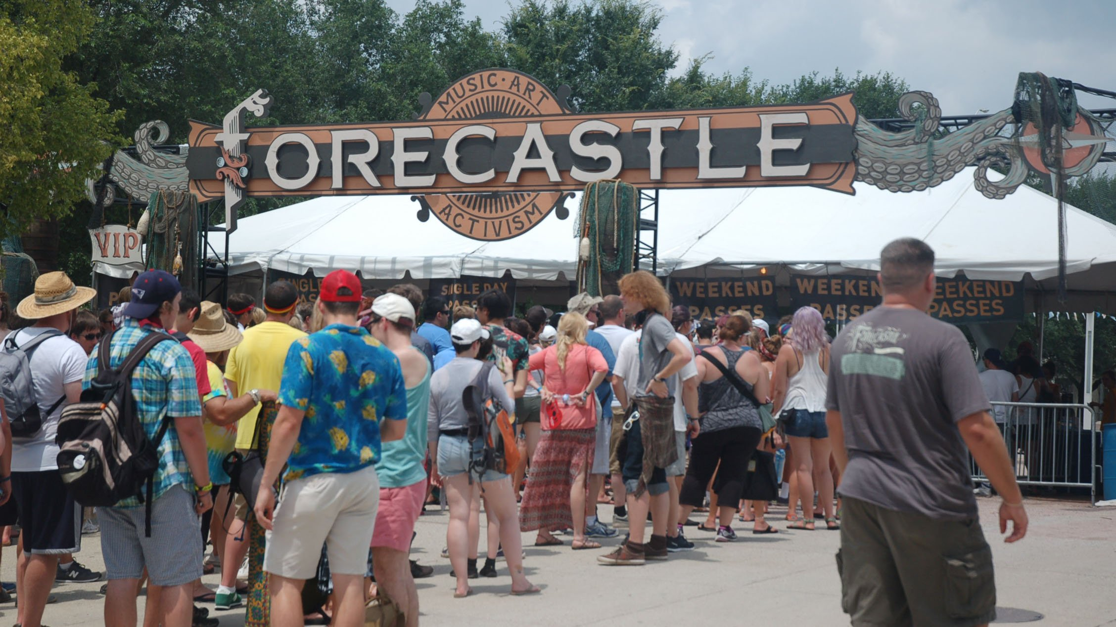 Lines await the delayed opening of the Forecastle gates on day 2 of the festival July 19, 2015.