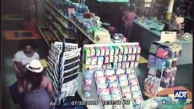 Surveillance footage provided by The Parent Teacher Store shows two women (Bottom left) putting tablets in backpacks.