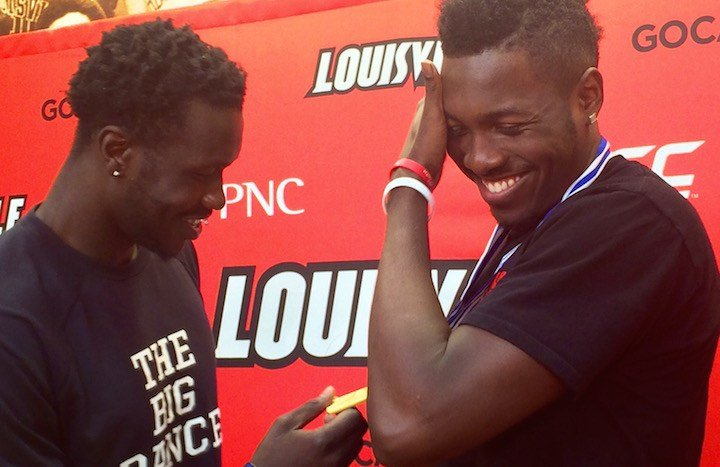 Mangok Mathiang checks out Chinanu Onuaku's gold medal from the U19 World Championships. (WDRB photo by Eric Crawford)