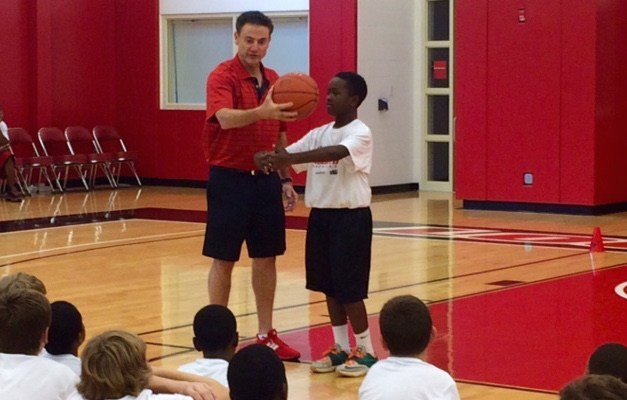 Louisville coach Rick Pitino talks to young players at the Robbie Valentine Summer Basketball Camp. (WDRB photo by Eric Crawford).