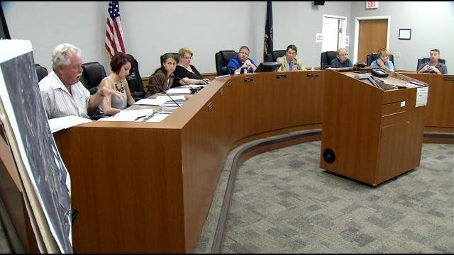 Shepherdsville city council members took no action on Mayor Scott Ellis at a meeting Tuesday night, July 28, 2015.
