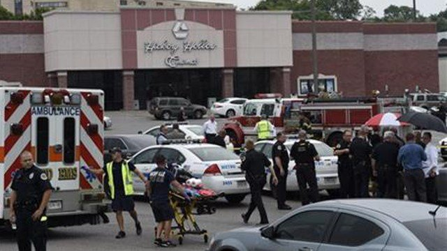 The suspect, who was not identified, was armed with a gun and hatchet at the Carmike Hickory 8 theater in Antioch, said Don Aaron, a spoke, man for Metro Nashville police. (AP Photo/Mark Zaleski)