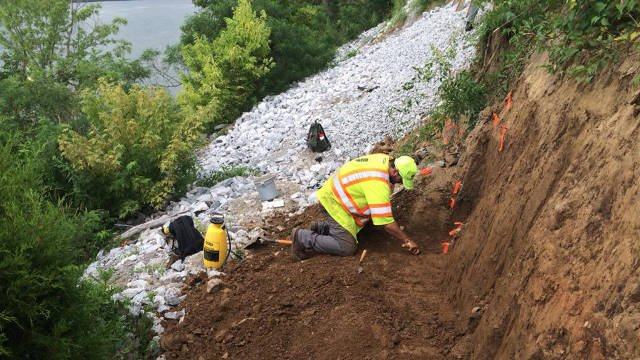 An archaeology team with INDOT is digging through the dirt near Horseshoe Casino, looking for historical artifacts that need to be preserved before roadwork can continue on a landslide off Highway 111.
