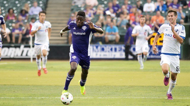 Kadeem Dacres races up field with the ball during Louisville City's 4-0 loss to FC Montreal Aug. 5. (Photo by Adam Creech)