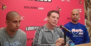 U of L basketball coach Rick Pitino (center) talked about his team's upcoming trip to Puerto Rico.