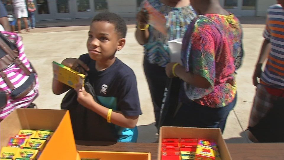 The Yum! Center gave out free school supplies at a block party Saturday (WDRB News photo)