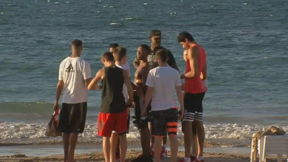 Coach Rick Pitino and the team landed in Puerto Rico Monday and headed for the beach to get settled in for their first games.