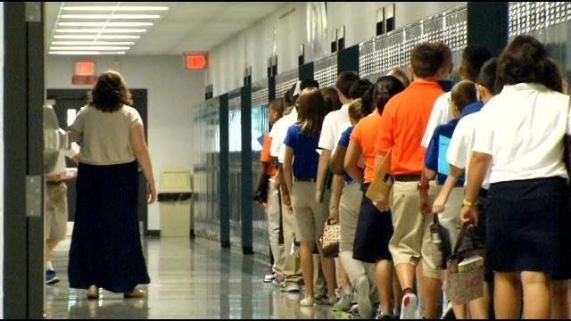 Ramsey Middle School students checked their lockers before heading into classrooms on the first day of school.