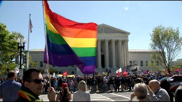Supporters of gay marriage celebrate outside the courthouse on the day oral arguments were made for and against Kentucky's gay marriage ban earlier this year (WDRB News File Photo).
