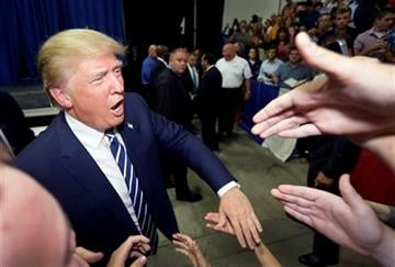 (AP Photo/Carlos Osorio). Republican presidential candidate Donald Trump meets supporters after addressing a GOP fundraising event.