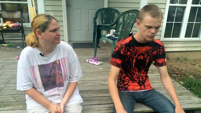 Risa Dean sits with her son, Kyle Lein (Photo by Toni Konz, WDRB News)