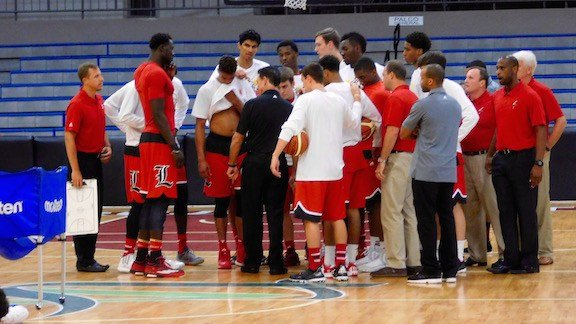 Rick Pitino speaks to his players and coaches before their final game in Puerto Rico. (WDRB photo by Eric Crawford)