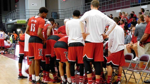 The Cardinals huddle during a late-game timeout in Puerto Rico. (WDRB photo by Eric Crawford)