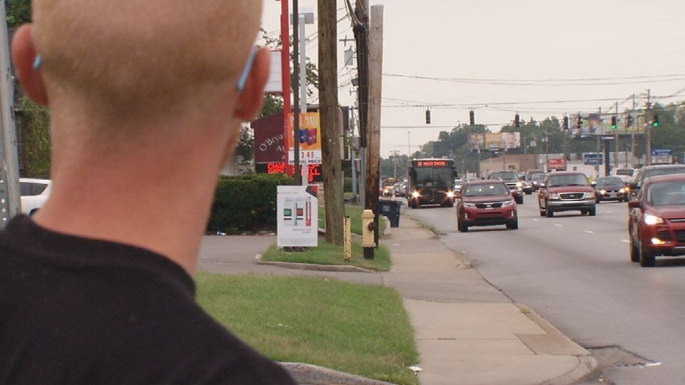 Kevin Johnson, who rides the 18 from Dixie Highway to his place of employment, waits for his TARC bus.