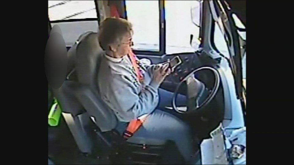 In this Jan. 5, 2015 file photo, surveillance video obtained by WDRB shows bus driver Linda Boldery texting while driving a school bus, with students on board.