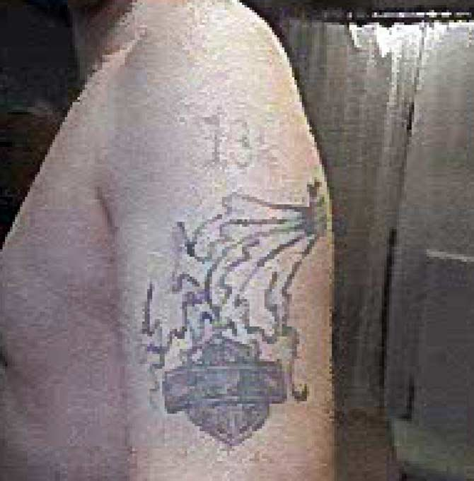 Police say escaped inmate Richard Shell has a Harley Davidson emblem tattooed on his left shoulder.