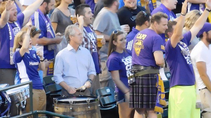 Louisville mayor Greg Fischer was beating the drum -- literally -- in the Louisville City Football Club crowd Saturday night. (WDRB photo by Eric Crawford)