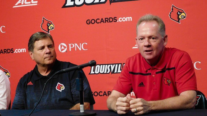 Louisville football coach Bobby Petrino and athletic director Tom Jurich discuss Papa John's Cardinal Stadium expansion. (WDRB photo by Eric Crawford)