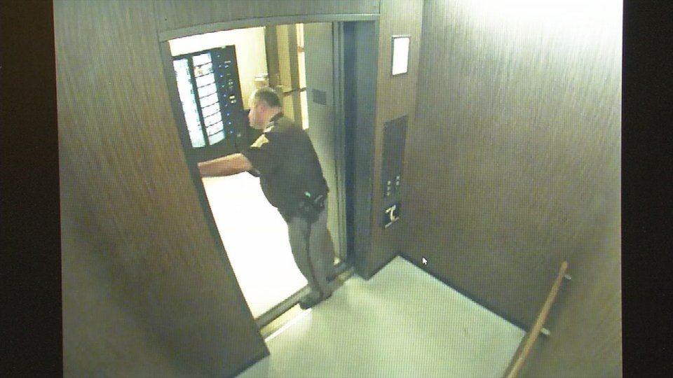A Clark County Sheriff's Deputy holds the elevator after noticing the suspicious package under the railing.
