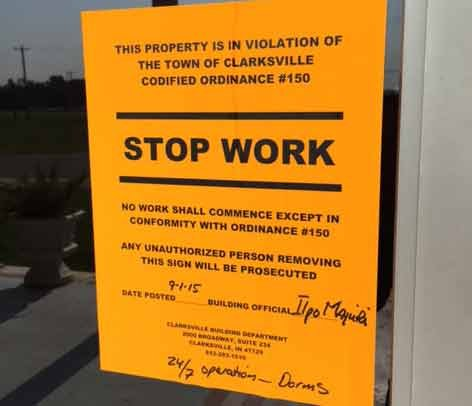 The building commissioner placed a stop work order on the church after finding it was operating without a license.