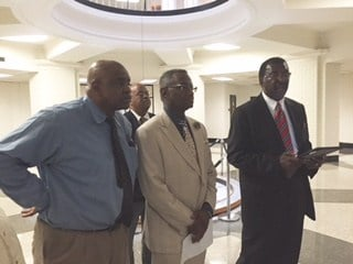 Protest led by(from right) Milton Seymore, chairman of the Justice Resource Center; Rev. Clay Calloway of the West Louisville Ministers Coalition; and Pastor Jerry Stephenson of the Midwest Church of Christ