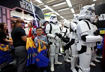 "(AP Photo/Kin Cheung). Star Wars fans shop at a toy store at midnight in Hong Kong, Friday, Sept. 4, 2015 as part of the global event called ""Force Friday"" to release new Star Wars toys and other merchandise of the new movie ""Star Wars: The Force Awakens."