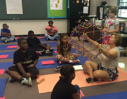 Lil Morris teaches her students breathing techniques as part of a calming routine (Photo by Toni Konz, WDRB News)