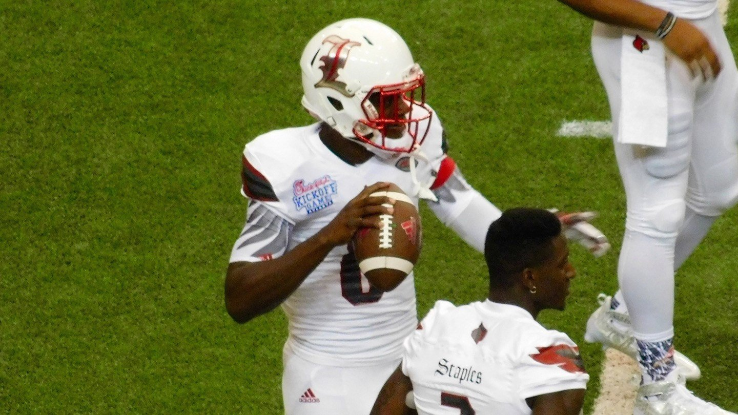 Lamar Jackson warms up. The freshman entered the game in the second quarter and gradually, began to change the game. (WDRB photo by Eric Crawford)