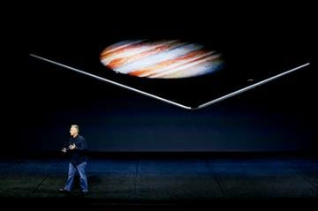 (AP Photo/Eric Risberg). Phil Schiller, Apple's senior vice president of worldwide marketing, discusses the new iPad Pro during the Apple event at the Bill Graham Civic Auditorium in San Francisco, Wednesday, Sept. 9, 2015.