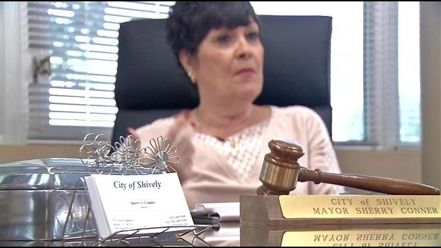 Mayor Sherry Conner explains her plans at her desk.