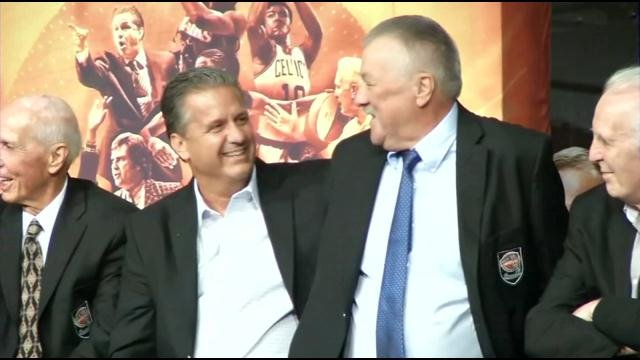 UK coach John Calipari and former Wildcat and Kentucky Colonel Louie Dampier enjoy their Hall of Fame blazer ceremony on Thursday. (WDRB photo by Mike Lacett.)