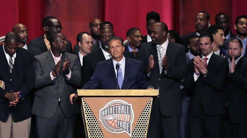 Kentucky coach John Calipari, surrounded by former players, near the end of his Hall of Fame acceptance speech. (AP photo)