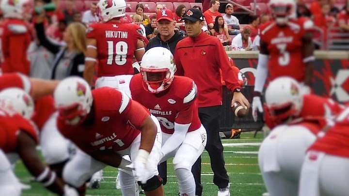 Bobby Petrino watches freshman QB Lamar Jackson warm up before Saturday's loss to Houston. With Clemson visiting Thursday, Petrino has another tough call to make at the position. (WDRB photo by Eric Crawford)