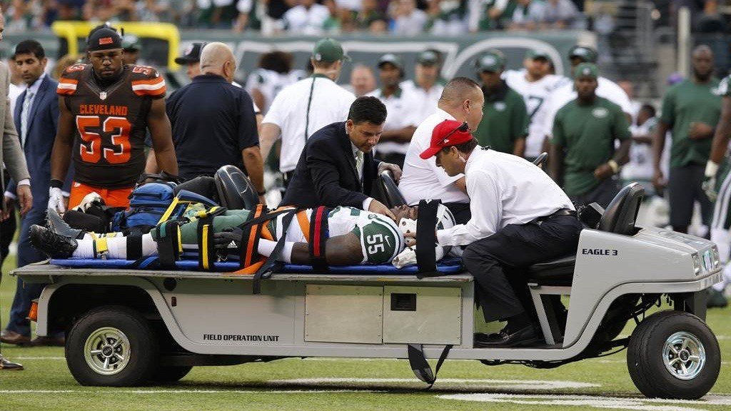 Jets rookie linebacker Lorenzo Mauldin is carted off after suffering a concussion in his NFL opener. (AP photo)