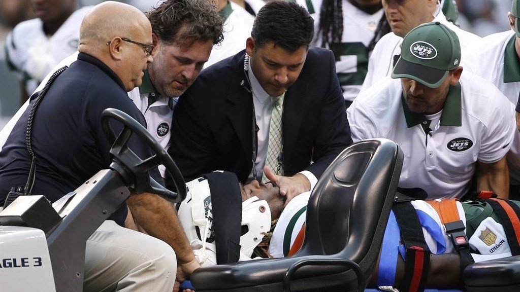 Trainers and medical personnel evaluate Lorenzo Mauldin, who was unresponsive on the field after suffering a concussion Sunday. (AP photo)