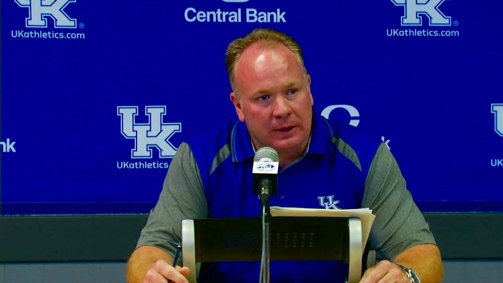 Mark Stoops talks with reporters at his Monday news conference.