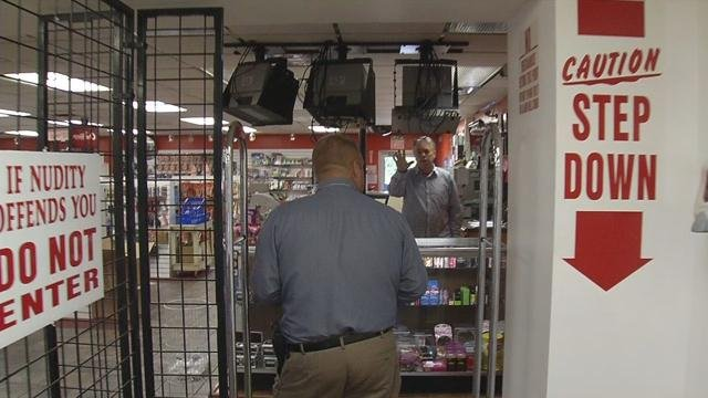 WDRB cameras were rolling as police hit the door at TheatairX in Clarksville during a raid on Sept. 15, 2015.