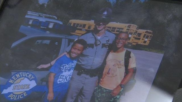 Trooper Joseph Ponder poses with students from North Hardin High School.