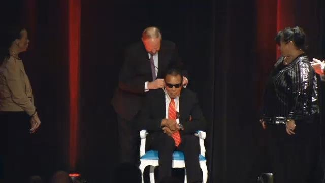 UofL President James Ramsey presents Muhammad Ali with the Grawemeyer Spirit Award on Sept. 17, 2015 at the Louisville Palace.