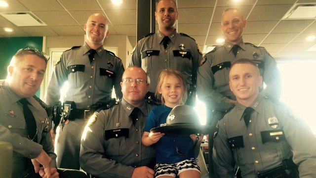 Left to right: Ohio State Highway Patrol trooper Sgt. Chris Smith, KSP Trooper Chris Lee, KSP Trooper Eric Homan, KSP Trooper Joseph Boyce, KSP Det. Jeff Kelley, Isabella Gregory and KSP Trooper Pat Hamilton