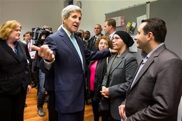 (AP Photo/Evan Vucci, Pool). US Secretary of State John Kerry meets with refugees fleeing Syria, at Villa Borsig, on Sunday, Sept. 20, 2015, in Berlin.