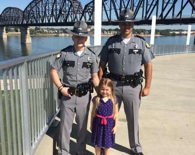 KSP Troopers Pat Hamilton and Eric Homan took Isabella to the playground at the Big Four Bridge in Louisville on Tuesday. (Photo by Toni Konz, WDRB News)